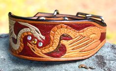 Dragon Leather Dog Collar - Tapered, Hand Carved. $72.00, via Etsy.
