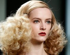 The classic curly look with straight hair in the upper part and little round…