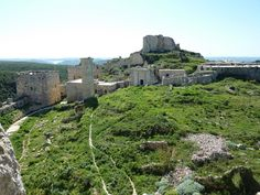 The Citadel of Salah Ed-Din (World Heritage Site by Unesco) is a castle in Syria. It is also known as Saône or Saladin Castle. It is located 7 km east of Al-Haffah town and 30 km east of the city of Latakia, in high mountainous terrain on a ridge between two deep ravines and surrounded by forest, the site has been fortified since at least the mid 10th century. In 975 the Byzantine Emperor John I Tzimiskes captured the site and it remained under Byzantine control until around 1108