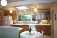 modern natural cherry cabinets with white appliances - Google Search