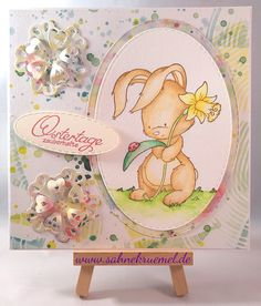 "Easter greeting card  - Stamp ""Bunny with Daffodil""; Designerpaper ""Mixed Media Colorful"" Marianne Design; ""Mini Die Flower"" XCuts;   ""XXL Nest-lies Stitched Ovals"" Crealies; Sentiment Iris-istible @Irishteddys; colored with Derwent Watercolour Pencils"