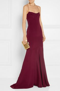 NARCISO RODRIGUEZ Silk gown$3,495 | arciso Rodriguez's burgundy gown is elegant and effortless. Cut to create an hourglass silhouette, this fluid silk design has a layered bodice and fluted hem. Delicate crisscross straps at the back frame your shoulders. We especially love it styled with simple gold accessories.  Shown here with: Kotur Clutch, Tamara Mellon Sandals, Chloé Cuff, Arme De L'Amour Ring, Arme De L'Amour Ring, Jennifer Fisher Choker, Jennifer Fisher Ring, Jennifer Fisher Arm…