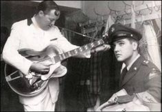 ♡♥Elvis Presley 7 months into his army experience relaxes backstage with Bill Haley on October 23rd,1958. Elvis stationed in the army in Germany dropped in on Bill's shows in Frankfurt and Stuttgart. Elvis is with Bill who is seen here tuning his guitar♥♡