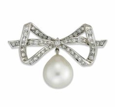 AN 18 CARAT WHITE GOLD, CULTURED PEARL AND DIAMOND BROOCH  Designed as a brilliant-cut ribbon bow surmount, suspending a pear shaped cultured pearl drop, hallmarked Birmingham, 1976, 4.2cm wide