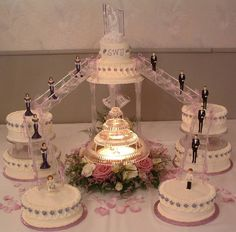 I love this idea as well! very pretty but I do really want the fountain under the middle cake other then that I love the layout of this cake the most!