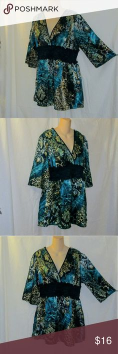 She's Cool Lowcut Satiny Plus Sized Blouse Sz 2X I have here and absolutely gorgeous low-cut, v-neck blouse made by She's Cool in size 2X. It is figure forming and satiny soft to the touch. It features a banded waist line with buttons. While this does fit a 2X, in my opinion it looks better on a 1x because of the way that it falls & the measurements, but that is up to you LOL. Laying flat measurements are: B-20, W-17, H-28, L-31 in. This particular garment of theirs runs a tad small. She's…