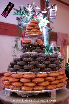 Donut tower cake as a substitute for the classic wedding cake.Unique cake for your wedding.Bride and groom can consider this in their wedding planning.This is unique yet very affordable. #weddingplanner #weddingdetails #weddingcake