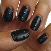 The season's most wicked tips are dark, daring and dotted. I love these nails.