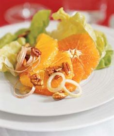 Lettuce, Orange, and Pecan Salad | Get the recipe: http://www.realsimple.com/food-recipes/browse-all-recipes/lettuce-orange-pecan-salad-10000001130750