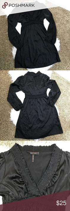 [BCBG MaxAzria] Silk Black Dress Adorable black dress. Long sleeves. Ruffle framing. 93% Silk 7% Spandex. This dress is in perfect condition except for the tag! Stitching has come out of one side. BCBGMaxAzria Dresses