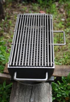 A serious hibachi grill, the Hibachinator, with stainless steel handles and a carbon steel grill top. This grill means business with a 8 x 24