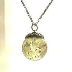 Dandelion Resin Globe Orb Necklace Sphere. $24.95, via Etsy.