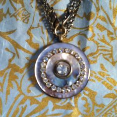 dwallacedesigns Mother of pearl buttons decorated with antique crystals.