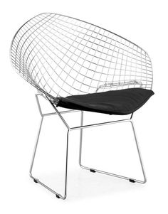 This classic mid-century modern chair features a solid welded steel chromed wire frame and a leatherette seat cushion. The Net Chair is available in black or white cushion colors.