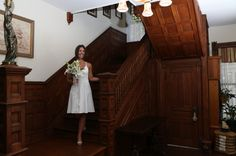 The bride walking down our Victorian stairs.