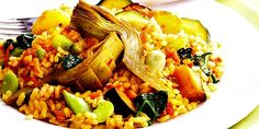 Vegetarian Paella: This vegetarian paella is so moist, full of flavor, and substantial, that you will scarcely notice it is meat-free. The green, red, and yellow bell peppers add a vibrant splash of color to the pale rice, while the tangy artichoke hearts, delicate peas, and juicy tomatoes ensure that this vegetarian paella will satisfy even the most avid carnivores.