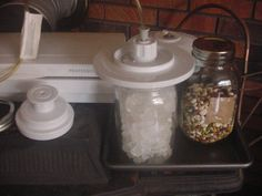 Set-up to seal jars. Vacuum tube attaches to a port on top of my sealer, just behind the tubing. I've had a vacuum sealer for several y. Mason Jar Meals, Meals In A Jar, Mason Jars, Food Saver Vacuum Sealer, Canning Recipes, Jar Recipes, Eat To Live, Home Food, Preserving Food