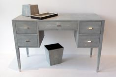 Yanna desk A classic modern beauty, functional as a desk or vanity. Fully wrapped in Shagreen with nickel feet and handles, drawer interiors in wood or suede.  Custom size and finishing available.