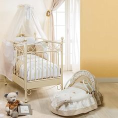 Pretty Baby Nursery With Metal Crib Featured Canopy : Choosing The Ideal Baby Nursery Furniture Pieces