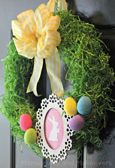 Easter Grass Wreath – Easter grass isn't just for your basket of eggs. The secret to getting it to stay in place on your door? Hairspray! Click for the full tutorial and for more easter wreaths.