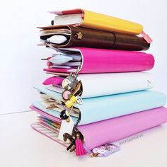 """Yummy planner stack: """"Pink Textured Leather Planner, Mint A5 Planner, Classic White Color Crush Planner, Dark Pink Color Crush Planner, Fauxdori Traveler's Notebook, Marigold Hobonichi Techo 2015"""""""