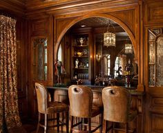 English Tudor --Bar in Walnut Paneled Billiards Room with antique etched glass inset panels. URL http://www.lindafloyd.com