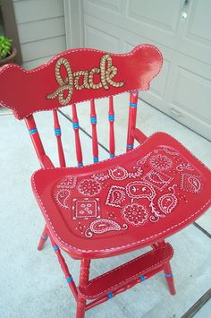 Handpainted high chair in cowboy theme.