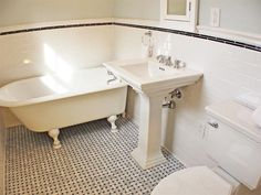 Marble basketweave and white subway tile, a pure white claw-foot tub, sink, and toilet combined with chrome accents complete a classic look. |  thisoldhouse.com
