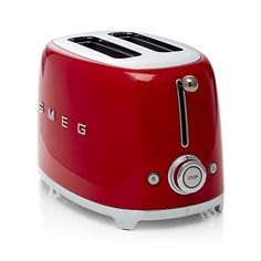 Known for their wonderfully retro appliances, Smeg has launched a joyfully designed small retro kitchen appliance collection based on the curved and compact lines of postwar design. Incorporating a 1950s-era aesthetic, Smeg's nod to the past is the star of today's kitchen, incorporating all the current advances in technology. Enameled in bright red and accented with a charming ball lever knob, the two-slice retro toaster browns bread at six levels with three convenient pre-set programs.