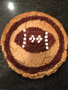 Giant Chocolate Chip Cookie. Chocolate buttercream football with marshmallow details.