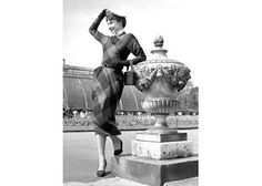 Tthis 1950 shot from London's Kew Gardens depicts Hepburn in a longer-hemmed ensemble that feels thoroughly Kate Middleton-approved, smiling ear-to-ear, pearls on. A wide variety of Hepburn's signature accessories are represented, such as her waist belt, beret, collared blouse and small handbag. How charming, no?