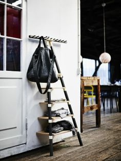 The IKEA PS shelf with knobs is designed to hold all the entryway essentials, from shoes to mail, in a narrow space.