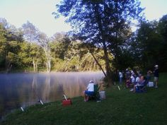 People fishing on the river.