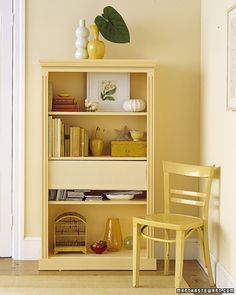 Roller shade in bookcase to hide junk...LOVE it!