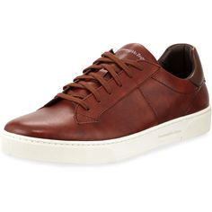 Ermenegildo Zegna Vittorio vulcanized sneakers in calfskin leather, handmade by Tuscan artisans. Round toe. Lace-up front. Logo branding at tongue. Contras…