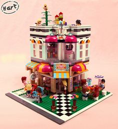 What happens when you combine the Lego Friends Downtown Bakery with the famous Lego Cafe Corner You get a Lego Friends Corner. Lego Friends, Lego Village, Lego For Kids, Lego Modular, Cool Lego Creations, Lego Storage, Lego Worlds, Lego House, Lego Projects