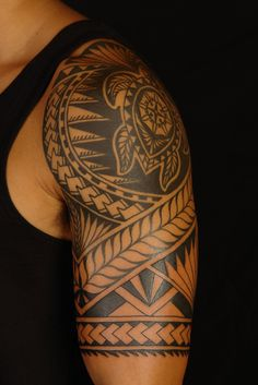 celtic polynesian arm tattoos