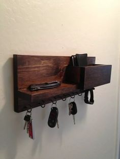 This is a key hook holder organizer for your mail, keys jewelry and most anything you need to keep organized. size - 16 L x 6 T x 4 deep this one is pine with dark walnut stain has 6 hooks and a dowel for your watch or bracelet necklace or ? Wall Key Holder, Key Holders, Wooden Key Holder, Diy Key Holder, Mail Holder, Key Organizer, Mail Organizer Wall, Key Jewelry, Key Rack