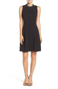 Free shipping and returns on Eliza J Bejeweled Neck Crepe Fit & Flare Dress at Nordstrom.com. Lustrous baubles trace the high mock neck of this classic LBD designed to flatter your figure with princess seams through the bodice and a gently pleat-flared skirt.