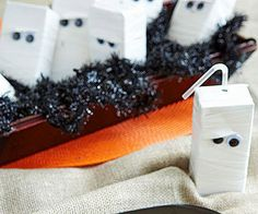 Make an army of mummies by wrapping juice boxes in white electrical tape ($4 for…