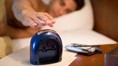 A man reaching for an alarm clock (Steve Hix/Somos Images/Corbis)