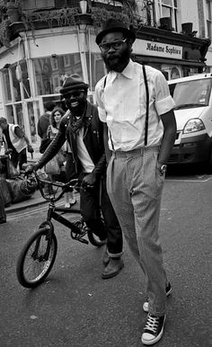 A little snazzy street style on display here: checked pants, thin suspenders and a hat made for tippin'. Via Beard Revered.