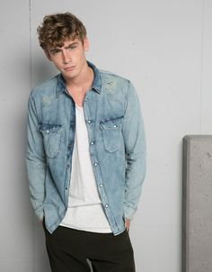 Stonewashed denim shirt. Discover this and many more items in Bershka with new products every week
