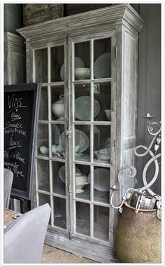 I love this distressed glass cabinet would love to have something like this when we redo our kitchen