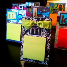 Post-it holders-clear plastic frame, scrapbook paper and supplies to embellish and pop-it note stick to front. Simple and cute idea.