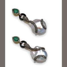 A pair of baroque South Sea cultured pearl, diamond, emerald and black onyx snake motif pendant earrings