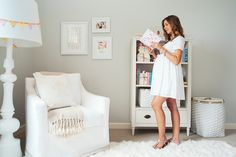 Camille Styles Nursery - love the wall decor, big white chair, and handmade detail on the white lamp