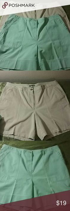 2 pair Ralph Lauren Shorts size 18W This is a two piece lot of Ralph Lauren shorts size 18 W. Both well taken care of and ironed all the time. The tan pair has slanted front pockets and two pockets in the back. Belt loops all around. The seafoam green pair have cargo Pockets at the waist, belt loops all around , two pockets at the back. Ralph Lauren Shorts Skorts