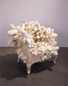 Yayoi Kusama (b. 1929), Accumulation, c. 1963. Sewn and stuffed fabric, wood chair frame, paint, 35 1/2 × 38 1/2 × 35 in. (90.2 × 97.8 × 88.9 cm). Whitney Museum of American Art, New York; purchase 2001.342. © Yayoi Kusama. Photograph by Tom Powel
