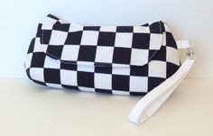 Hey, I found this really awesome Etsy listing at http://www.etsy.com/listing/150774613/black-and-white-checkered-clutch-with